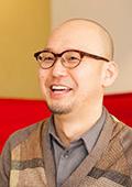 運営メンバー(写真は主宰の田中陽明)